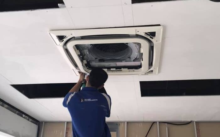 LK Brothers crew aircon servicing